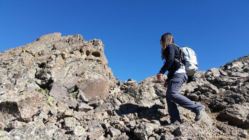 Christina Hiking To The Summit of Wetterhorn Peak